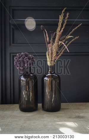 Dried flowers in a vase on wooden table stock photo