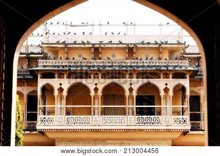 Balcony of Mubarak Mahal in Jaipur City Palace Rajasthan India. Maharaja Residence. Old Indian architecture with carving and ornament. View through the gate of the main entrance. Wide angle