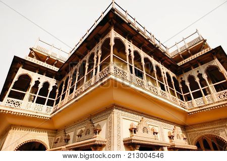 Balcony of Mubarak Mahal in Jaipur City Palace Rajasthan India. Maharaja Residence. Old Indian architecture with carving and ornament. Wide angle