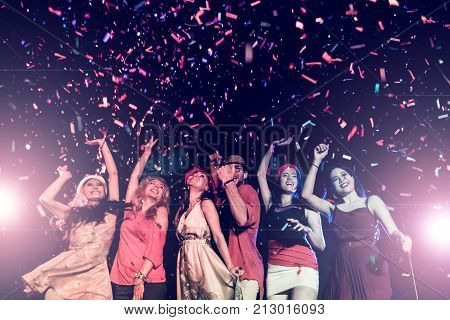 new year party holidays celebration nightlife and people concept - Young people having fun dancing at a party. poster