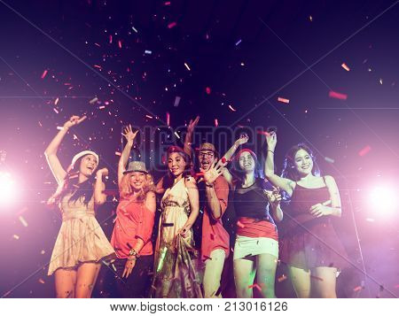 new year party holidays celebration nightlife and people concept - Young people having fun dancing at a party.