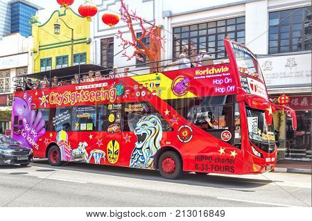 SINGAPORE SINGAPORE - FEBRUARY 17 2017: Touristic bus in Singapore. Singapore City Tour is a touristic bus service that shows the city with an audio guide.