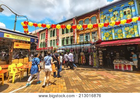 SINGAPORE SINGAPORE - FEBRUARY 17 2017: Bustling street of Chinatown district in Singapore. Singapore Chinatown is a world famous bargain shopping destination.