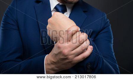 Business Man Massaging His Wrist In Closeup