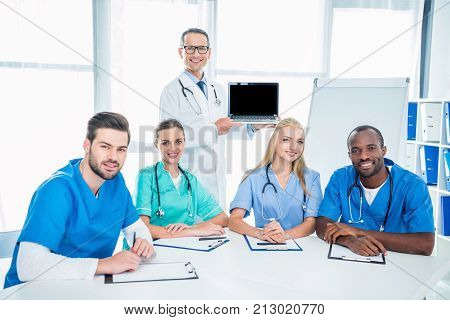 Nurses And General Practitioner With Laptop