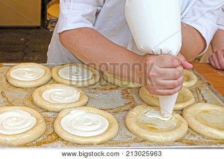 Czech traditional cheesecake - kolache. -- Stock Photo #157205676 Women bakery at work. Process of makin. Czech traditional baked. Traditional moravian kolache.