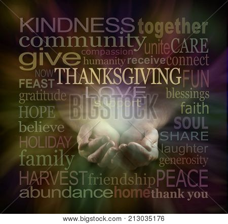 Share your Love at Thanksgiving - male cupped hands surrounded by a muted color THANKSGIVING word cloud on a dark background with a light emerging from hands