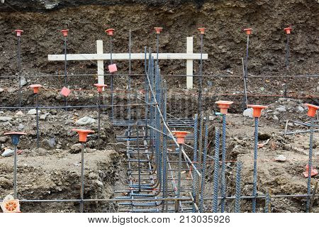 Construction Site View Looking Down Footings With Gridwork Of Rebar, Horizontal Aspect