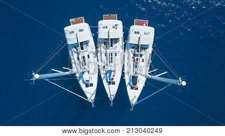 Aerial view of yacht sailing near beautiful Islands. Beautiful clouds in the background. Luxury yacht in the sea.