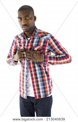 Portrait of African male unbuttoning a checkered shirt staring into the camera in studio