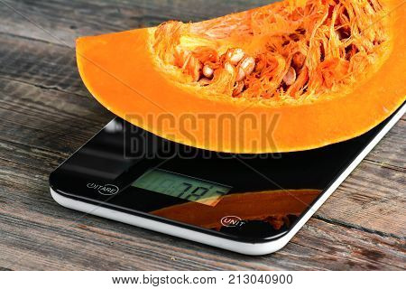 Cut Pumpkin On The Scales