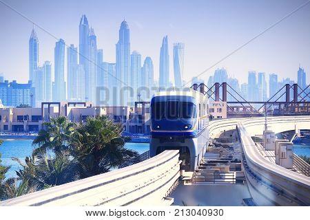 Modern tram in Dubai. Tram moving from Dubai downtown to Palm island.