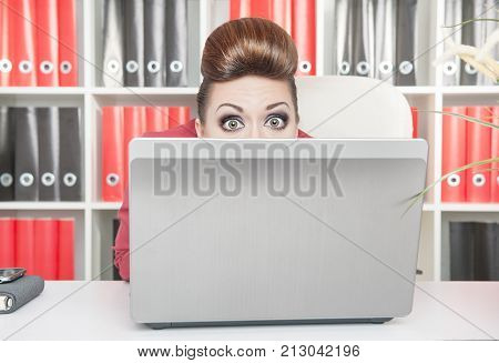 Business Woman Afraid And Hiding Behind The Computer