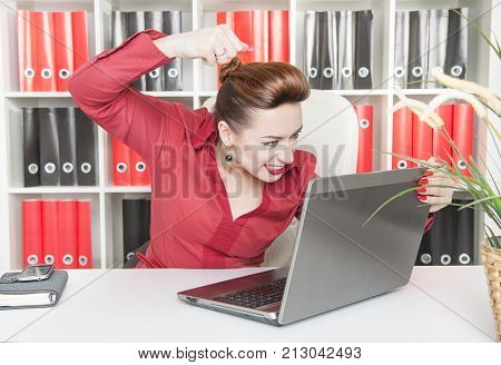 Angry Business Woman Beat Laptop With Her Fist