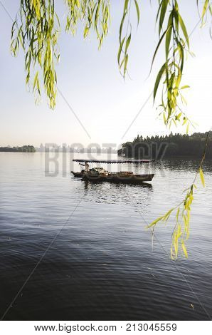 HANGZHOU, CHINA - JULY 30, 2012 - Rowing boat on West Lake, Hangzhou