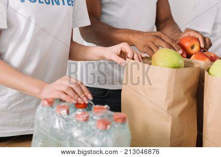 Volunteers With Charity Goods