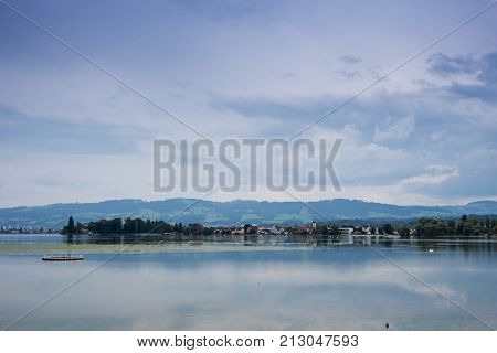 Mountains valley lake Constance and peaks landscape natural environment. Hiking in the alps. Arbon Switzerland Europe