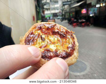 Holding a Macanese Egg Tart Macau China