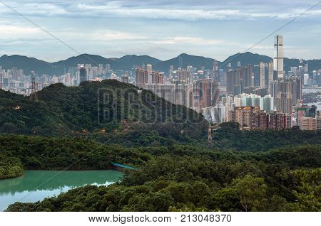 HONG KONG - JULY 7, 2013 - View of the Hong Kong skyline as seen from Kam Shan, Kowloon. Kam Shan is a mountain in Kam Shan Country Park, Northern Kowloon.