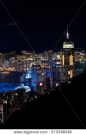 WANCHAI HONG KONG - MAY 31 2013 - Central Plaza skyscraper illuminated at night as seen from Stubbs Road Hong Kong Island