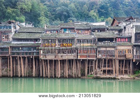 FENGHUNG CHINA - NOV 12 2014 - Traditional stilt houses on the Tuojiang River Fenghuang China