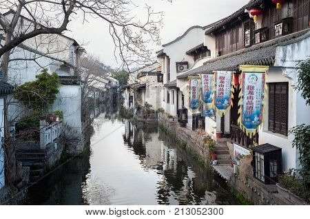 SHAOXING, CHINA - FEB 19, 2015 - Traditional whitewashed buildings line a canal in the eastern Chinese city of Shaoxing.