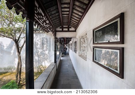SUZHOU, CHINA - FEB 13, 2015 - Outdoor cloister at the Lion Grove Garden, Suzhou. The garden is located in the Pingjiang area of Suzhou and is part of the Suzhou classical gardens World Heritage Site.
