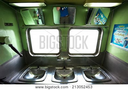 THAILAND - JUNE 9 2015 - Washing area and sinks onboard a Thai intercity train.