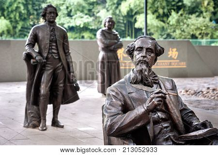 SHANGHAI, CHINA - SEPT 9, 2015 - Statue of Charles Dickens at the World Literary Giant Square, Lu Xun Park, Shanghai