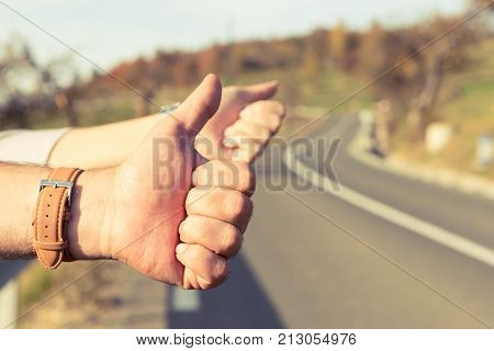 Hand Of A Couple Of Hitchhikers Or Travelers