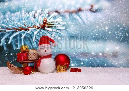 Christmas snowman with red scarf and santa claus hat , isolated on blue winter background. Happy New 2018 Year background with Snowman .
