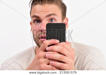Macho With Headphones Listens To Music. Man With Surprised Face