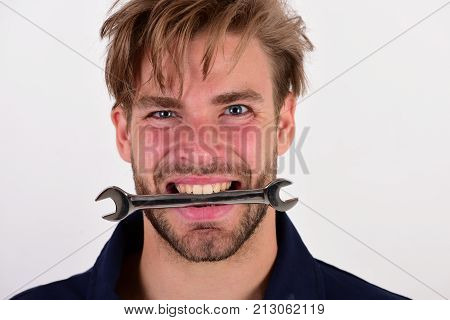 Spanner Instrument For Fixing Or Tightening Details. Man Holds Wrench