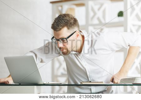 Tensed Man Working On Project