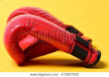 Boxing Gloves In Red Color On Yellow Background.