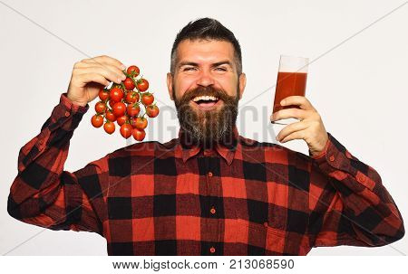 Man With Beard Holds Glass Of Juice And Vegetables