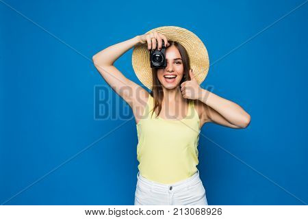Close Up Photo Of Woman In Hat On Blue Taking A Photo With Digital Camera