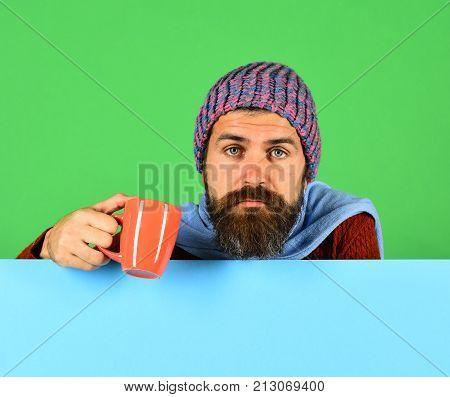 Fall Season And Influenza. Man With Beard Holds Orange Cu