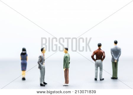Miniature People : Small Figures Businessmen Stand On White Background With Copy Space And Using As