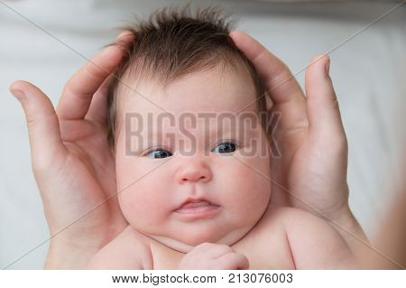 Infant baby in fathers hands happy fatherhood