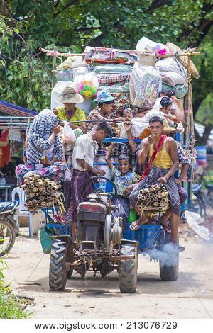 SHAN STATE MYANMAR - SEP 06: Burmese farmers riding on an old tractor in a village in Shan state Myanmar on September 06 2017 agriculture is the main industry in Myanmar