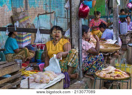 SHAN STATE MYANMAR - SEP 06 : Burmese women selling chiken in a market in Shan state Myanmar on September 06 2017. Agriculture is the main industry in Myanmar
