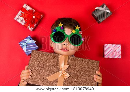 Cute Boy With Christmas Presents