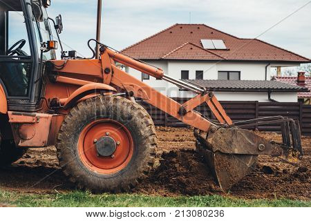 Industrial Bulldozer Moving Earth And Doing Landscaping Works