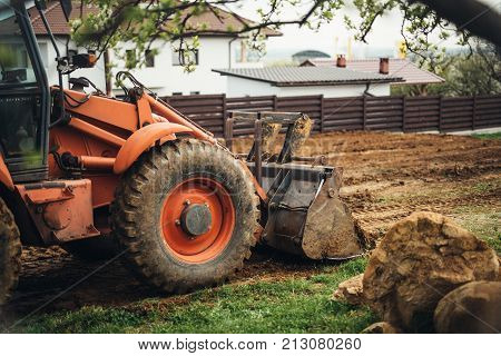 Heavy Duty Industrial Bulldozer Moving Earth In The Garden