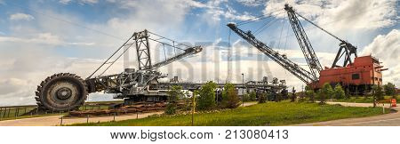 Heavy equipment for oil sands industry red crane and huge digger