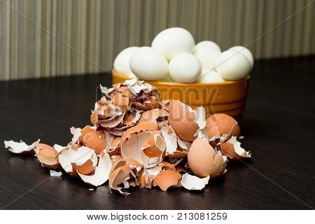 Bunch of boiled and peeled eggs end eggshell in a bowl. Concept of food and organic farm products.