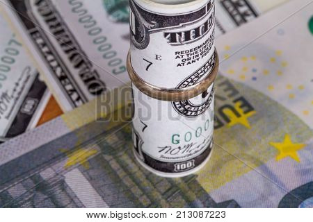 Banknotes With Marriage Ring In Finance Concept
