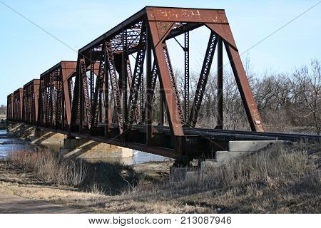 Steel Railroad Bridge spanning the river and sandbars