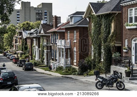 Quebec City, Canada 13.09.2017: cars parked in front of European architecture row houses in Old Quebec Canada editorial